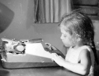 Elizabeth Wein with her first typewriter as a small child